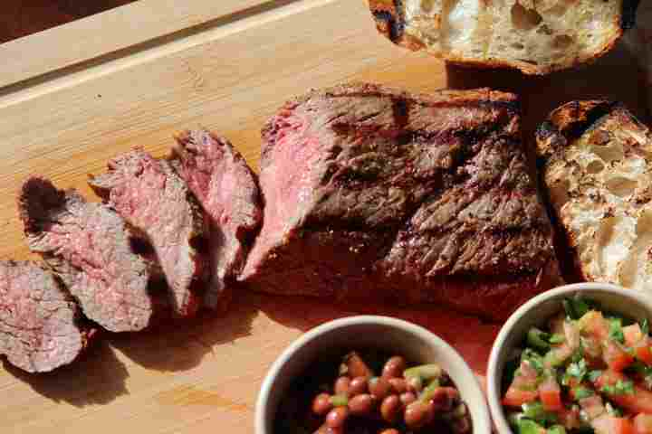 Grilled Tri Tip with traditional side dishes of pinquito beans, Santa Maria Salsa and crusty grilled bread