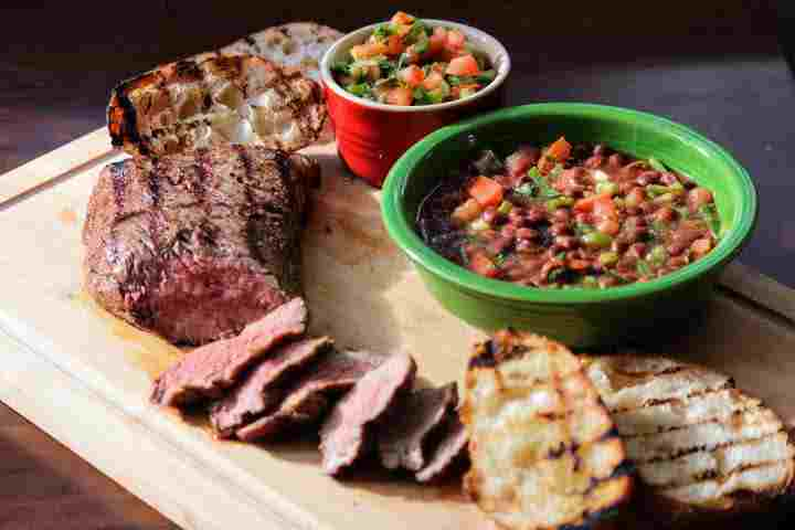 Tri tip with pinquito beans, grilled bread, and Santa Maria Salsa.