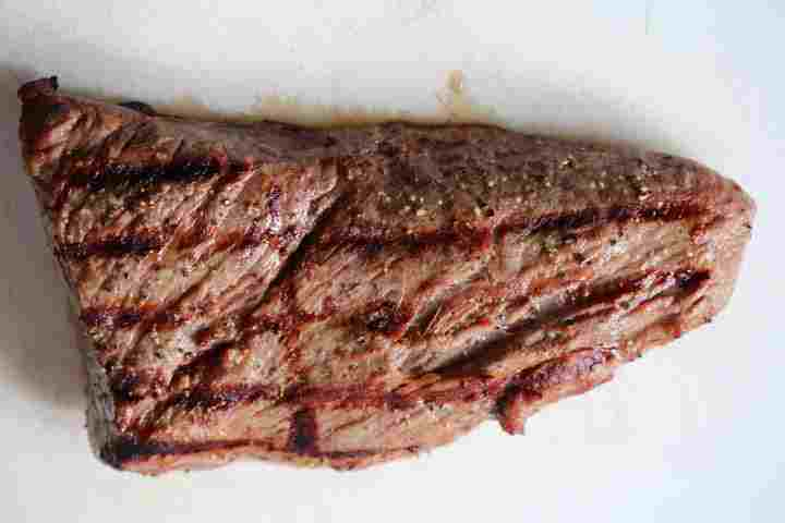 Grilled beef tri tip resting on a cutting board