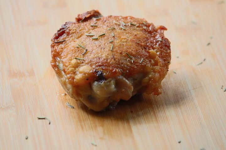 Chicken thigh with golden-brown crispy skin, a product of starting it in a cold pan on stovetop first.