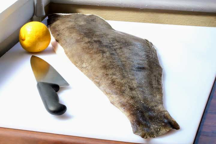A 5-pound halibut fillet skin side up on a cutting board