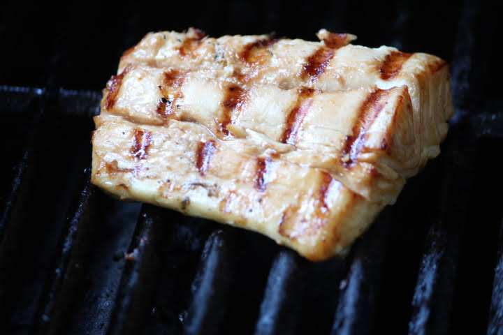 A halibut fillet on a gas grill