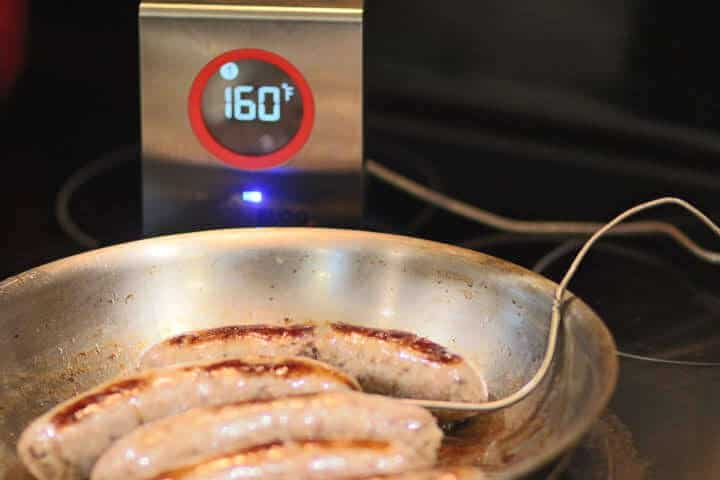 Bratwursts cooked to 160 degrees Fahrenheit in a skillet