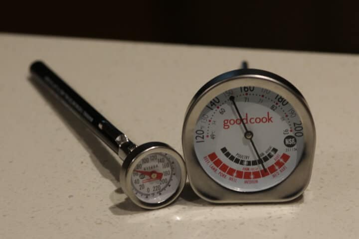Examples of an instant-read analog meat thermometer on the left and an oven-safe analog meat thermometer on the right