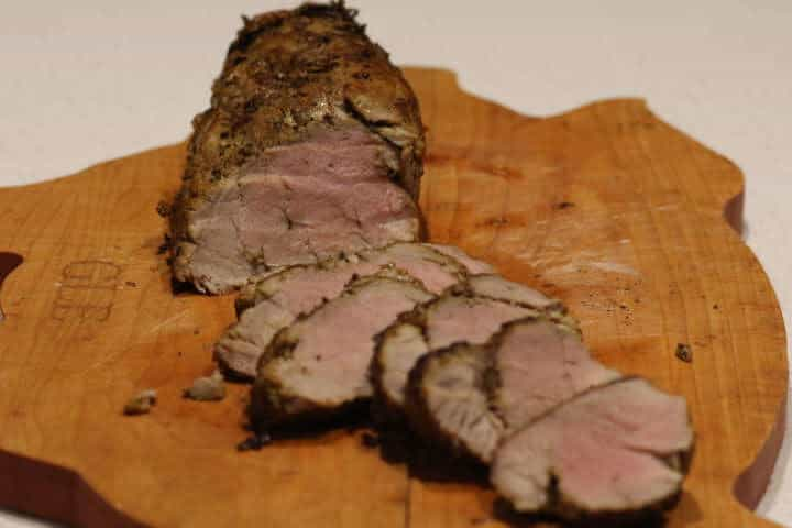 Pork tenderloin cooked to 145 degrees in a cast-iron skillet