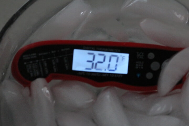 Submerging the Alpha Grillers meat thermometer in ice water