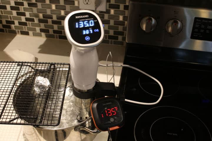 The Inkbird testing 135 degrees Fahrenheit in a 135 degree sous vide bath