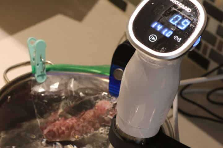 Cooking a pork sausage in a 141 degree Fahrenheit sous vide water bath