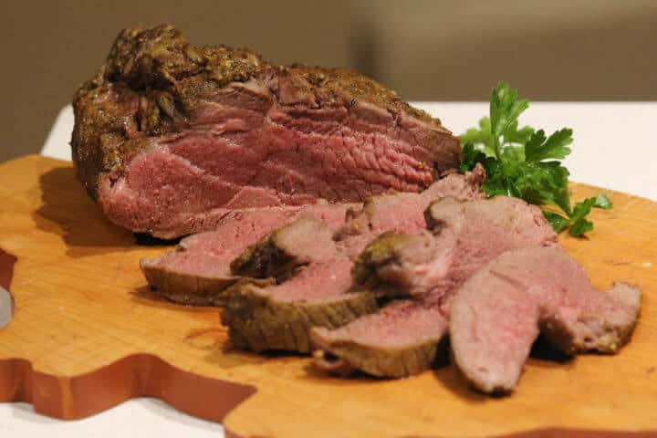 Leg of lamb cooked to an internal temperature of 135 degrees Fahrenheit.