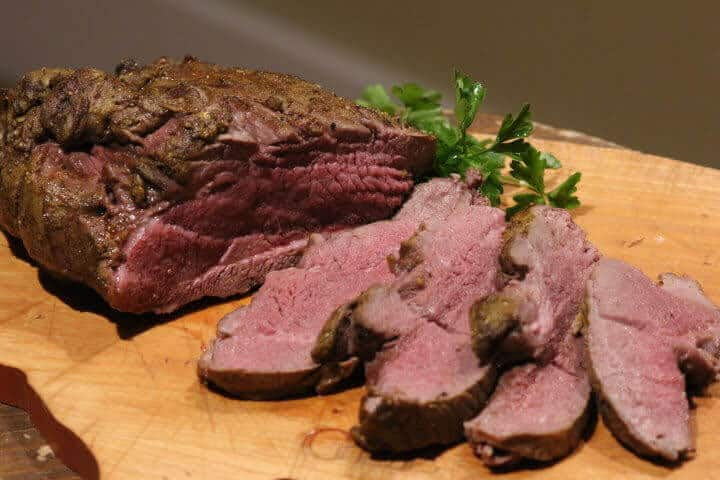 Leg of lamb cooked to 135 degrees Fahrenheit, sliced