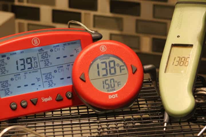 The Thermoworks Signals, the DOT, and the Thermapen MK4 in a sous vide waterbath
