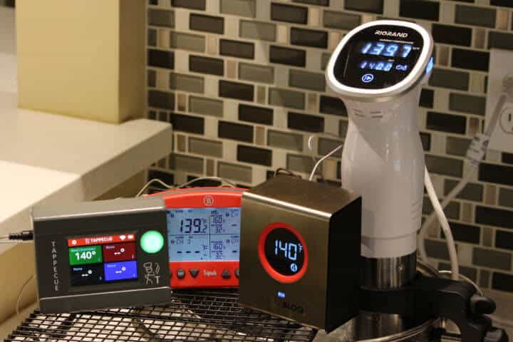 The Tappecue touch, Thermoworks Signals, and the SmokeBloq WiFi meat thermometers in 140 degree water.