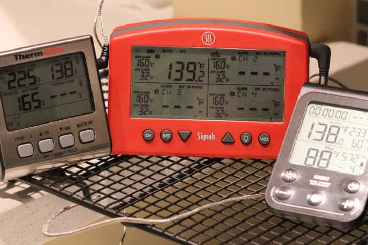 The ThermoPro TP-17, Thermoworks Signals and the Lavatools Element meat thermometers measuring 140 degree sous vide water.