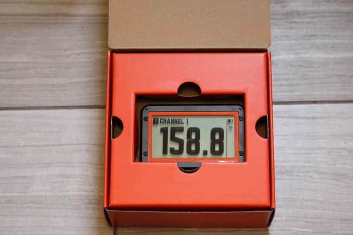 The open box of the Fireboard 2 Drive thermometer revealing the thermometer