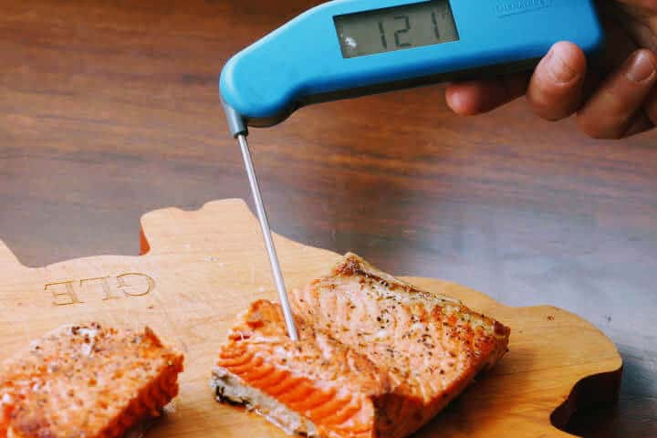 Classic Thermapen temping salmon at 121 degrees Fahrenheit