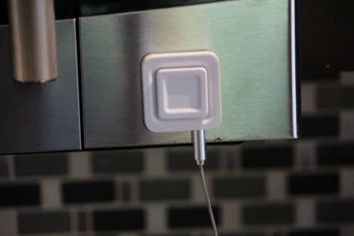 The Carbon Lite using its magnet to stick to microwave