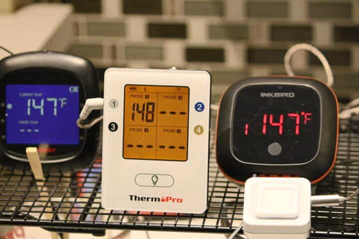 The Tenergy Solis Bluetooth meat thermometer, Thermopro TP 25 Bluetooth Meat Thermometer, the Inkbird IBT-4xs Bluetooth meat thermometer and the Lavatools Carbon Lite Bluetooth meat thermometers monitoring a 148 degree Fahrenheit water bath