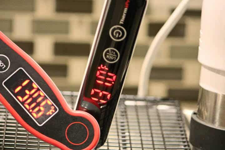 The ThermoPro TP19 (on left) and the ThermoPro TP18 meat thermometer (on right) measuring a sous vide water bath