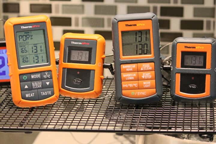 ThermoPro TP20 and ThermoPro TP08S remote meat thermometers measuring the temperature of a 131 degree sous vide water bath