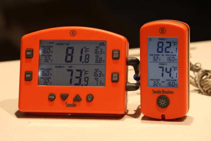 Thermoworks Smoke thermometer transmitter and receiver in between signal updates reading different temperatures on their respective displays.