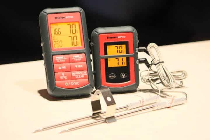 ThermoPro TP08B Dual Probe Wireless Meat Thermometer with both its transmitter and receiver and its two food probes and grate clip