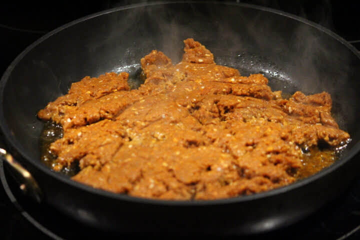 Ground chorizo sausage crumbles in a skillet on the stovetop