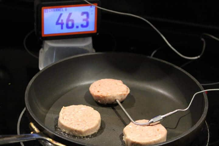 Monitoring the internal temperature of turkey sausage cooking in a pna over medium heat with a probe thermometer