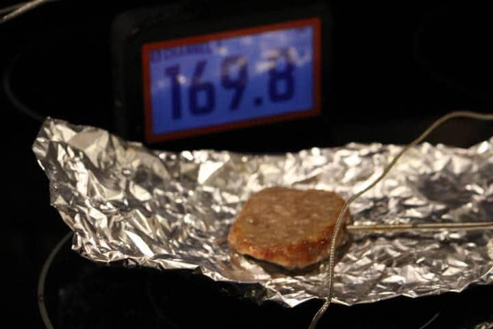 Pork breakfast sausage in foil measuring 169 degrees Fahrenheit