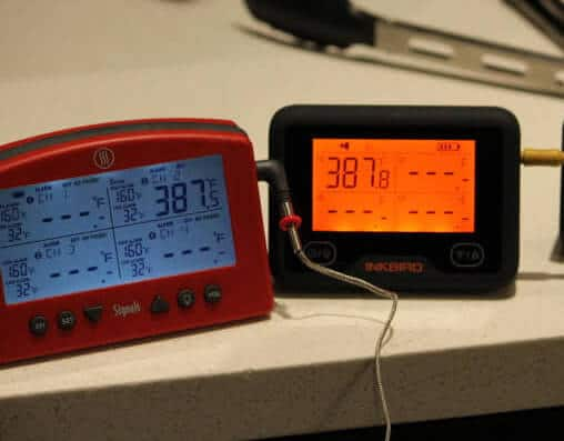 The Inkbird IBBQ-4BW and Thermoworks Signals WiFi meat thermometer measuring oven temperature.