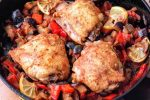 Chicken thighs with crunchy skin in a cast iron skillet with Samfaina