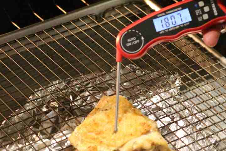 The internal temperature of a baked chicken is 180.7 degrees Fahrenheit as displayed on the G Dealer DT09 Instant Read Meat Thermometer