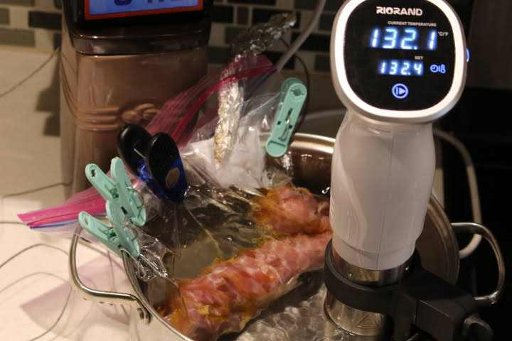 Cooking a pork tenderloin in a sous vide water bath set at 132 degreess Fahrenheit.