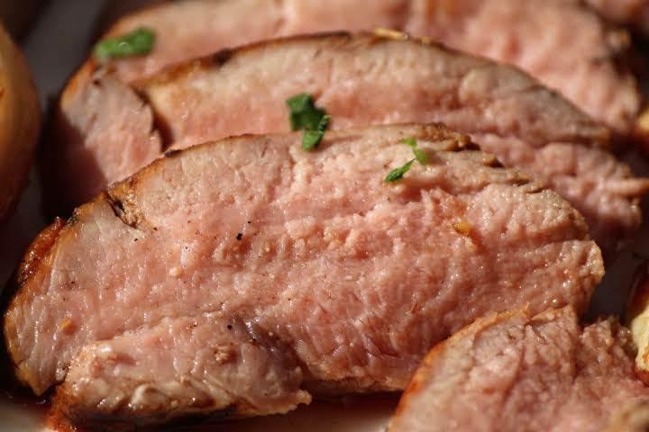 Slices of pink-hued pork tenderloin