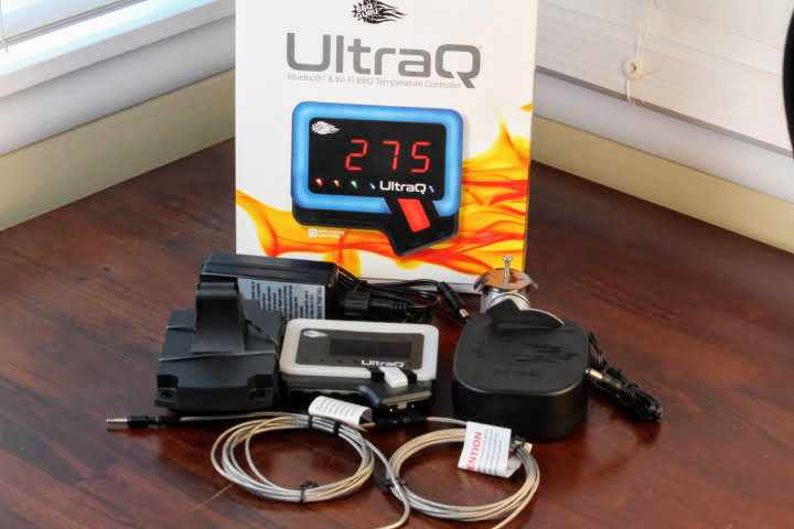 The BBQ Guru Ultra Q Temperature Control Kit unboxed with all of its components on a table