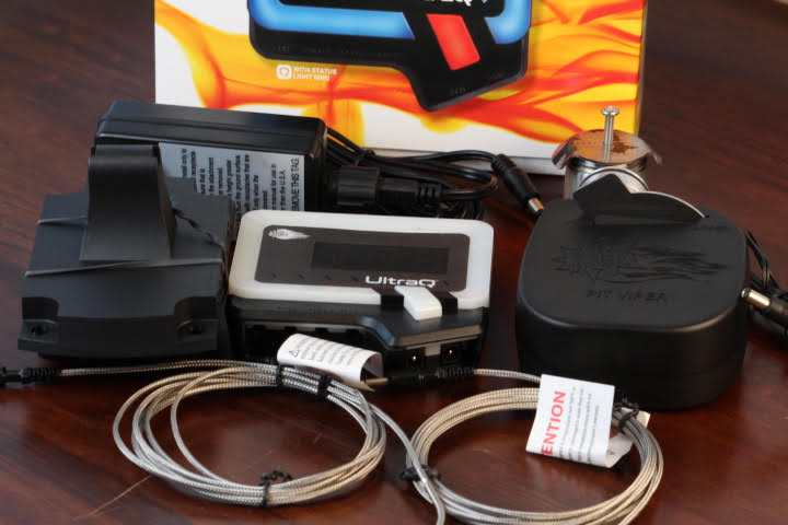 The BBQ Guru Ultra Q Temperature Control Kit unboxed with all of its accessories