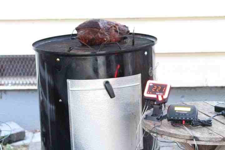 A pork shoulder being tracked by the BBQ Guru UltraQ on a Weber Smokey Mountain Grill