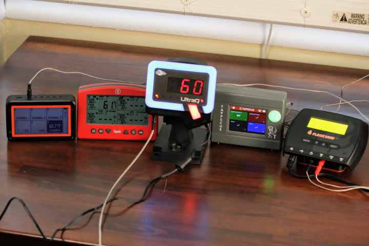 The top five Wifi temperature controllers on the market from left to right: The Fireboard 2 Drive, Thermoworks Signals, BBQ Guru UltraQ, Tappecue Touch, and the Flame Boss 500