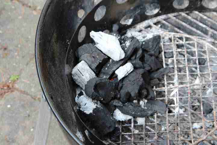 Building a dual-zone fire in a charcoal grill with all of the charcoal on one side of the grill
