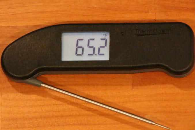 A black Thermapen ONE thermometer registering 65.2 degrees Fahrenheit on its display screen