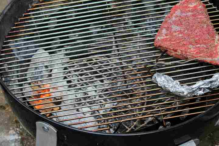 Smoking a tri tip on a Weber kettle style grill using a two zone fire to smoke it indirectly