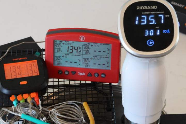The Inkbird IBBQ-4T and the Thermoworks Signals measuring the temperature of a sous vide water bath set at 135.7 degrees Fahrenheit