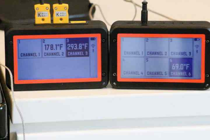 The FireBoard 2 Pro on the left displaying its three probe channels with the FireBoard 2 Drive on the right displaying six channels